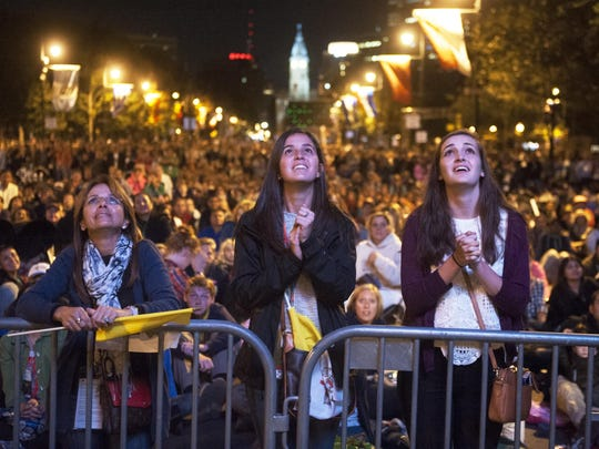 Crowd members watch as Pope Francis speaks during the Festival of Families held on the Benjamin Franklin Parkwayi n Philadelphia Saturday evening. 09.26.15