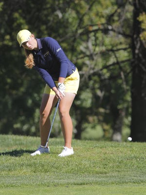 St. Ursula's Carolyn Markley chips one onto the green at the Weatherwax Golf Course in Butler County