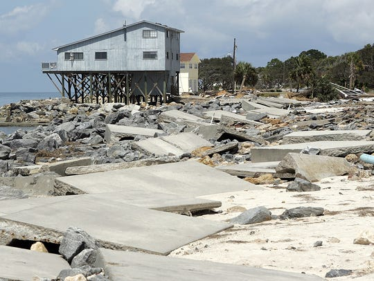 Alligator Point Road was reduced to rubble after Hurricane