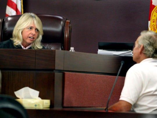Judge Jackie Fulford, left, asks fisherman Jonas Porter