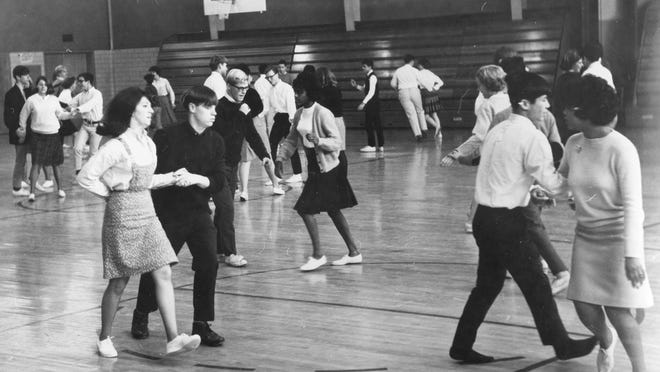Barnstable High School students participate in a square dancing program at the school in 1966.