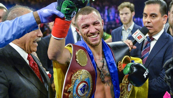 Vasiliy Lomachenko, who resides in Camarillo, smiles after defeating Jose Pedraza last Saturday night in New York.