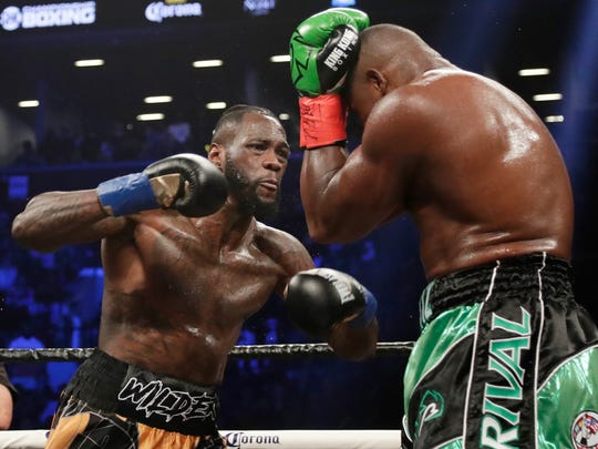 FILE - In this March 3, 2018, file photo, Deontay Wilder, left, fights Luis Ortiz during the third round of the WBC heavyweight championship bout in New York. Wilder won in the 10th round.Whatever disappointment Wilder may have had in not fighting Anthony Joshua or Tyson Fury next is gone. The heavyweight champion can't wait to get in the ring with Dominic Breazeale. (AP Photo/Frank Franklin II, File)