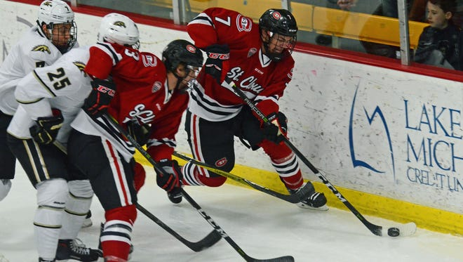 St. Cloud State forward Nick Poehling skates with the puck by the net as teammate Jack Poehling looks on Saturday in Kalamazoo, Mich.