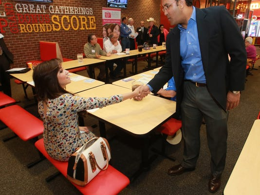 VICTOR CALZADA-EL PASO TIMES U.S. Rep. Will Hurd greeted Selene Barron of Liberty Mutual Insurance Wednesday at a business roundtable in Horizon City.