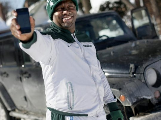 Brian Brunson, 37, of Detroit is a high school coach, entrepreneur and Uber car service driver in his free time.