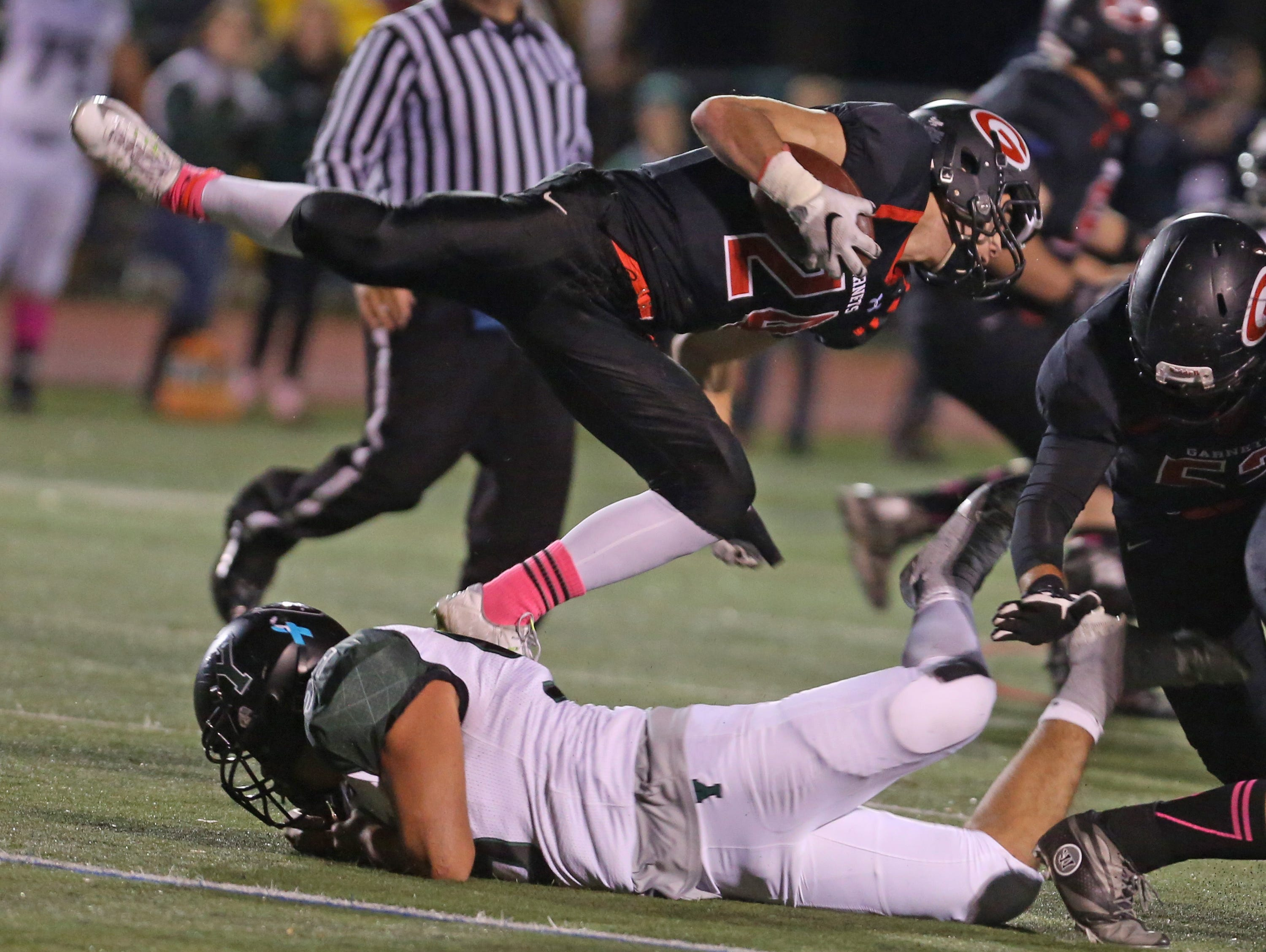 Rye's Jamie Chabot is brought down while rushing against Yorktown during a Class A semifinal football game against Rye at Rye High School Oct. 30, 2015.