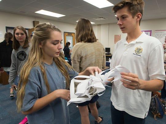 Gulf Breeze High School student, Blake Barclay, right,