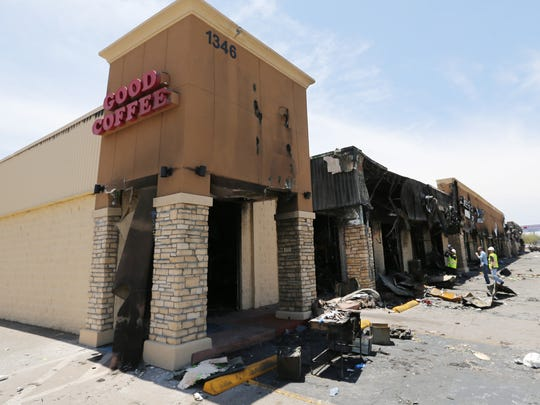 The Treviño Village shopping center was heavily damaged by a fire Monday. Inspectors were busy Tuesday reviewing the damage.
