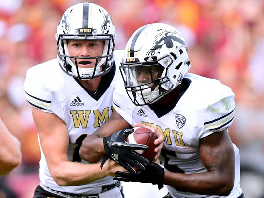 Western Michigan quarterback Jon Wassink, right, and running back LeVante Bellamy return to lead the Broncos' offense. Bellamy was first-team All-MAC a year ago, rushing for 1,228 yards.