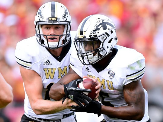 Western Michigan QB Jon Wassink, left, made his first career start against Southern Cal. LeVante Bellamy helped the Broncos rush for 263 yards against the fourth-ranked Trojans.