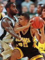 In this Jan. 21, 1999 game, Michigan State's Mateen Cleaves, left, pressures Iowa's Dean Oliver. Iowa lost to the Spartans 80-65.