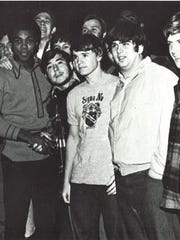 Muhammad Ali shakes hands with Evangel College students