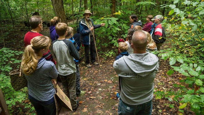Indiana Master Naturalist Gary Frank leads guests on a fall foliage hike through Wesselman Woods during a previous Harvest Festival.
