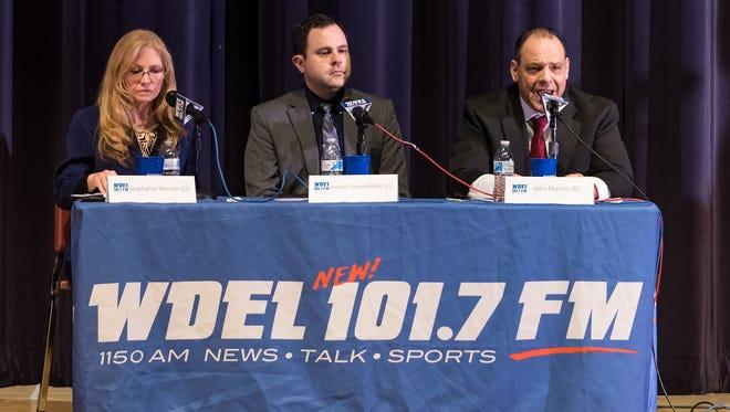 Stephanie Hansen (far left), Joseph Lanzendorfer, and John Marino make remarks at the 10th Senate District debate at Middletown High School.