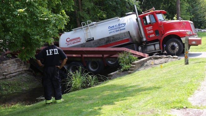 A septic-tank cleaning truck fell through a bridge and dumped 2,000 pounds of waste into a creek near 79th Street and Westfield Boulevard.