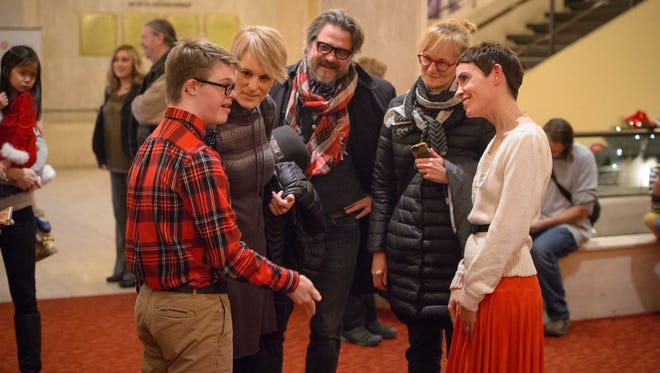 "Jackson Hickey (left), his mother Jayne Schroeder, Michael Bathke and Linsey Sieger visit with Milwaukee Ballet costume staff member Krista Allenstein during the sensory friendly ""Nutcracker"" event in 2016."