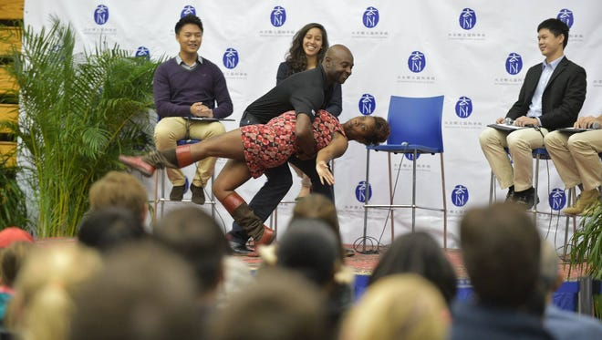 Menya Jefferson, a big Jerry Rice fan and a dance team sponsor, has a story book moment with the NFL star... in CHINA.