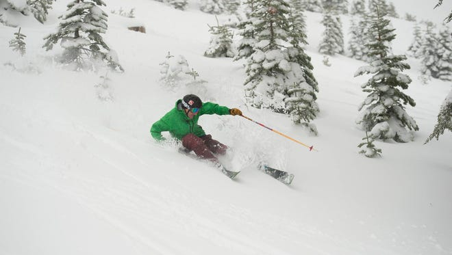 A skier on fresh snow at Squaw Valley Alpine Meadows on Wednesday. Storms have been moving through the Sierra Nevada.