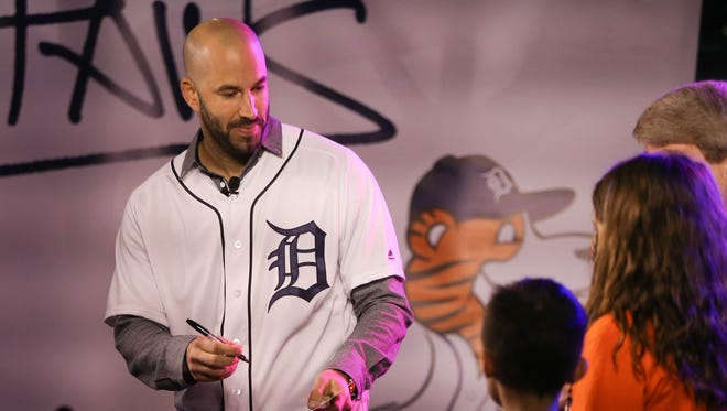 Tigers pitcher Mike Fiers signs autographs during TigerFest at Comerica Park on Saturday, Jan. 27, 2018.