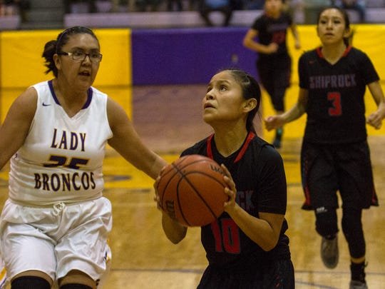 Shiprock's Melanie Secody goes up for a layup against Kirtland Central on Tuesday at Bronco Arena in Kirtland.