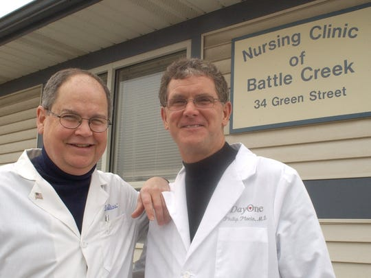 Drs. John Collins, left, and Philip Ptacin in 2003.