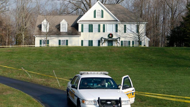 A police cruiser sits in the driveway of the 3,100-square-foot home of Nancy Lanza, in Newtown, Conn., on Dec. 18, 2012, four days after her son's murderous rampage.