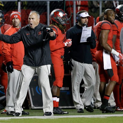 Rutgers coach Kyle Flood, front left, reacts to a call