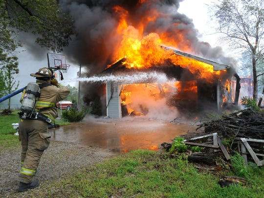 A Mountain Home firefighter battles a house fire. This is the time of year to make sure fireplaces, wood stoves and heating units are in good working order.