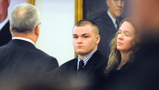 Kyle Dube, center, with his attorneys Stephen Smith, left, and Wendy Hatch is in court during the first day of Dube's trial at the Penobscot Judicial Center in Bangor, Me., Monday, Feb. 23, 2015. Dube is charged with kidnapping and murder in the 2013 death of Nichole Cable, a high school sophomore from Glenburn, Me.  (AP Photo/The Bangor Daily News, Gabor Degre, Pool)