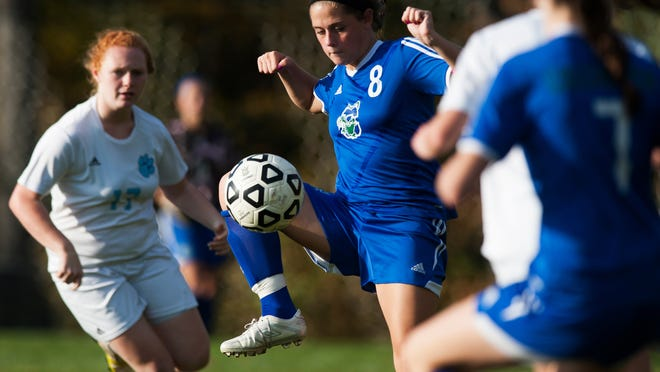 Colchester's Avery Finelli (8) plays the ball during a girls soccer game at Mount Mansfield on Tuesday.
