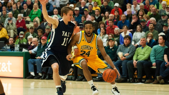 Guard Dre Wills (24) helped Vermont to a 68-54 win over Maine on Wednesday night.