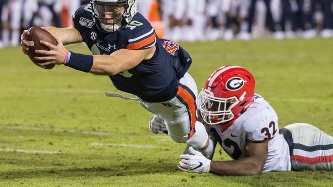 Auburn quarterback Bo Nix dives in for a running touchdown against Georgia last season at Jordan-Hare Stadium in Auburn, Ala. No. 8 Auburn will host No. 23 Kentucky this weekend.