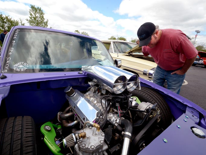 Duane Stroik of Milwaukee checks out the motor and