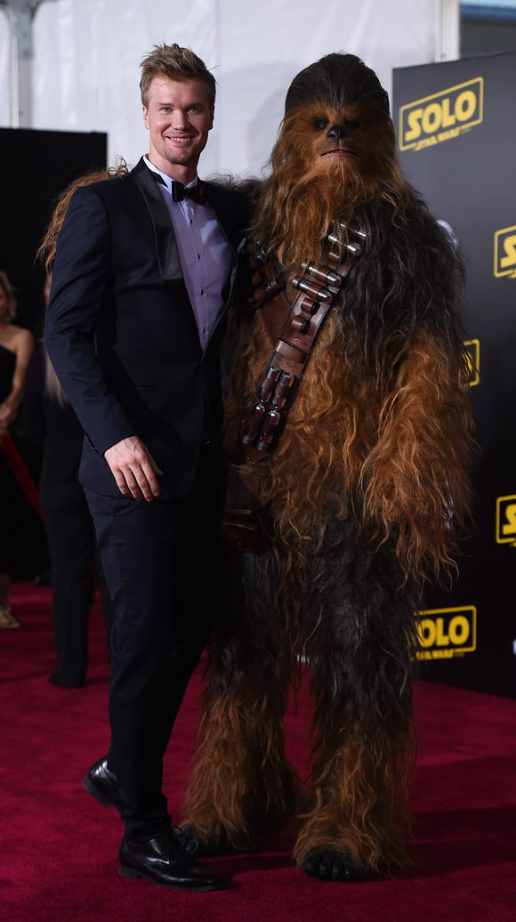 Joonas Suotamo, left, and (a seemingly shorter) Chewbacca