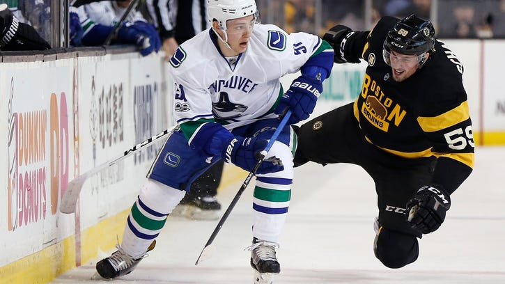 Cassidy wins 2nd straight as Bruins' coach, 4-3 over Canucks