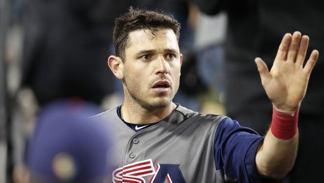 U.S. infielder Ian Kinsler celebrates after scoring on an RBI single by Christian Yelich in the fifth inning against Puerto Rico on March 22, 2017.