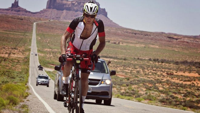 Dave Haase rides through Monument Valley, Utah. Haase finished second in the 2015 Race Across America, a 3,000-mile endurance race.