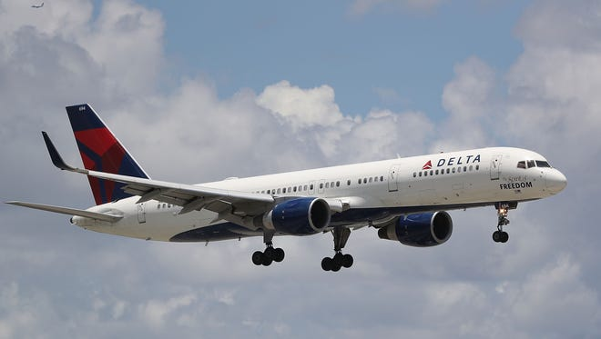 A Delta airlines plane is seen as it comes in for a landing at the Fort Lauderdale-Hollywood International Airport on July 14, 2016 in Fort Lauderdale, Florida.