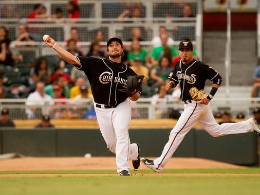 Chihuahuas 3B Brett Wallace attempts to throw out a runner at 1st base.  El Paso, Saturday, May 30, 2015.