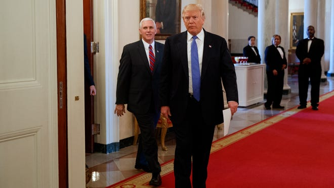 In this file photo, President Donald Trump, followed by Vice President Mike Pence, arrives for a meeting with manufacturing executives at the White House Feb. 23, 2017.