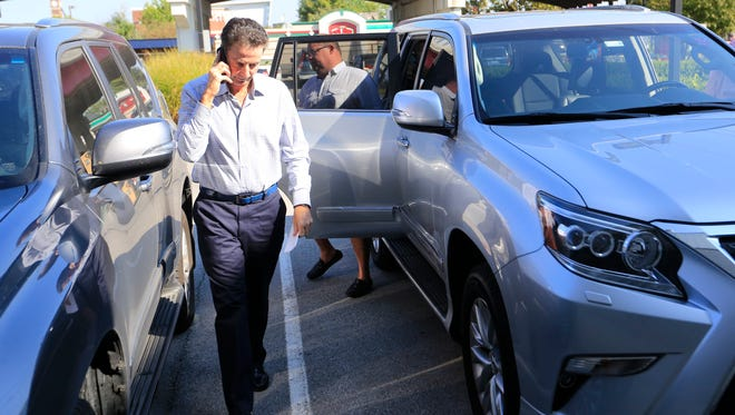 Louisville basketball coach Rick Pitino arrived back at the Yum Center practice facility after meeting with U of L's President. Pitino was placed on leave after an FBI investigation implicated the school in illegal recruiting activities. Sept. 27, 2017.