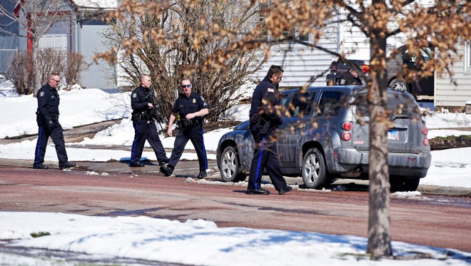 Police investigate a report of shots fired near 14th Street and Willow Ave Thursday, March 24, 2016.