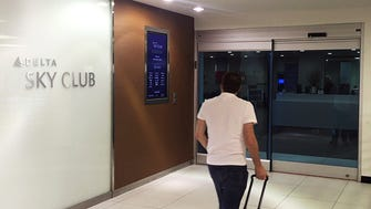 In this photo from May 11, 2017, AP journalist Scott Mayerowitz enters the Delta Air Lines SkyClub at New York's JFK International Airport.
