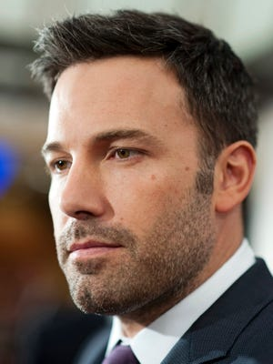"""This Oct. 10, 2012, file photo shows director and actor Ben Affleck posing for photographers at the premiere of his film Argo in Washington. Affleck might be Batman to his four-year-old son Samuel, but that doesn''t mean that he'll get to see his dad in action in """"Batman v Superman: Dawn of Justice"""" with the rest of the world when it hits theaters next week. """"Four years old is a little young to see this whole movie,"""" Affleck said Friday from the Warner Bros. studio lot in Burbank."""