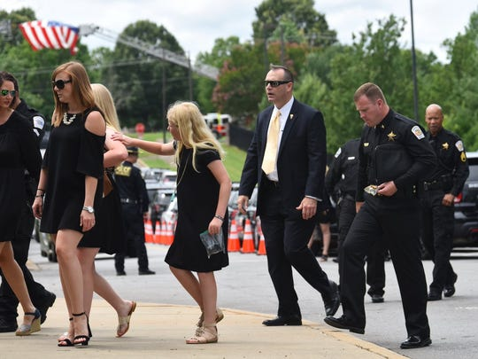 Mourners begin to arrive at Civic Center for the funeral of deputy Devin Hodges.