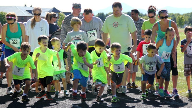 Children take their first running steps during a one-mile race for kids, which was part of the larger eighth annual Vermont Remembers Run on Sunday at Camp Johnson in Colchester.