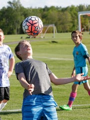 Lucca Tonelli, 12, of Wausau, chest bumps the ball Wednesday, June 1, 2016, during practice drill at the Eastbay Sports Complex in Wausau.