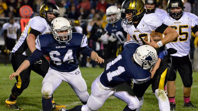 Watkins quarterback Westley Brandon is tackeled by Granville's Patrick Chaykowski in the first half of the game on Friday.  Watkins defeated Granville 42 to 17 on Friday, October 16,2015.