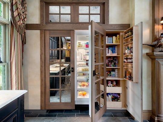 Hidden refrigerator-freezer design created by The Hammer & Nail, Ridgewood